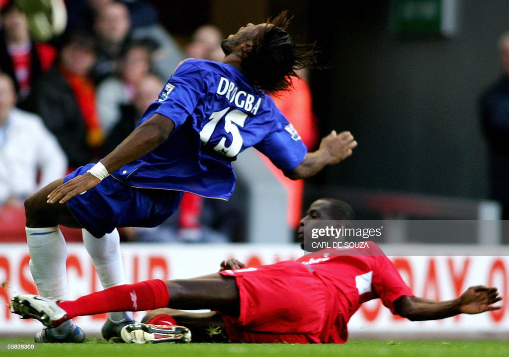 Chelsea's Didier Drogba is fouled by Liverpool's Djimi Traore during their premiership match at Anfield football grounds, Liverpool 02 October 2005. Chelsea won the game 4-1.