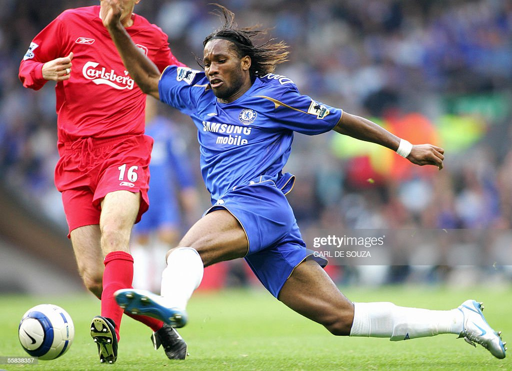 Chelsea's Didier Drogba stretches for the ball, past Liverpool's Dietmar Hamann during their premiership match at Anfield football grounds, Liverpool 2 October 2005. Chelsea won the game 4-1.