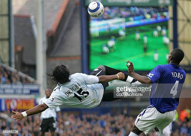 Didier Drogba of Chelsea attempts a bicycle kick watched by Joseph Yobo of Everton during a premiership match at Goodison park in Liverpool 23...