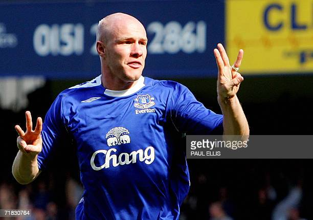 Everton's Andrew Johnson celebrates scoring the third goal against Liverpool during their English Premiership football match at Goodison Park...