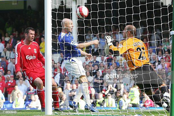 Everton's Andy Johnson puts the ball past Liverpool's goalkeeper Jose Reina during their English Premiership football match at Goodison Park in...