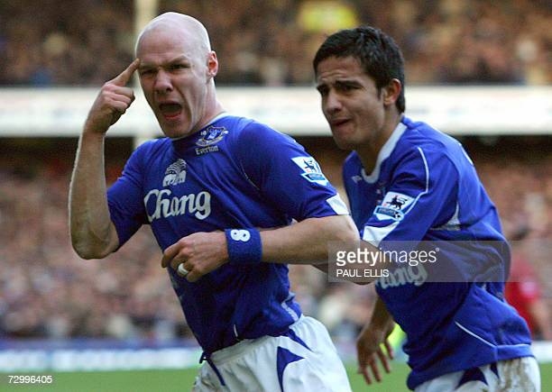 Everton's English forward Andrew Johnson celebrates with Everton's Australian midfielder Tim Cahill after scoring against Reading during their...