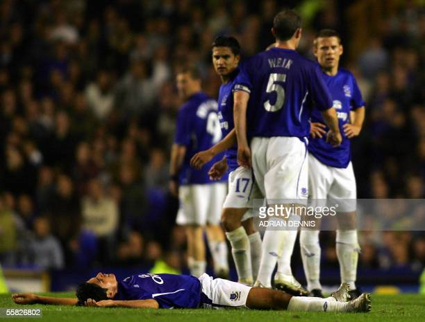 Liverpool, UNITED KINGDOM: Everton's Mikel Arteta lies injured on the field after a tackle by Mihaita Plesan of Dinamo Bucharest during the UEFA Cup...
