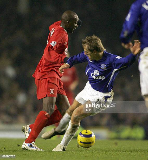 Everton's Phil Neville gets a second yellow card for this challenge on Liverpool's Momo Sissoko during a Premiership match between Everton v...
