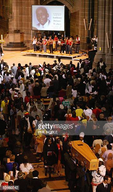 Family members follow the coffin of murdered teenager Anthony Walker as it is carried from Liverpool Cathedral following his funeral Thursday August...