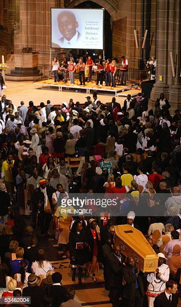 Family members follow the coffin of murdered teenager Anthony Walker as it is carried from Liverpool Cathedral following his funeral 25 August 2005...