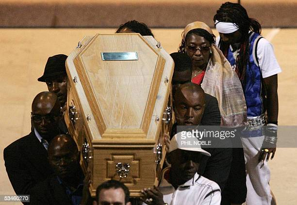 Gee the mother of murdered teenager Anthony Walker follows his coffin as it is carried from Liverpool Cathedral following his funeral Thursday August...