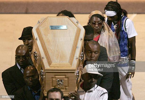 Gee the mother of murdered teenager Anthony Walker follows his coffin as it is carried from Liverpool Cathedral following his funeral 25 August 2005...