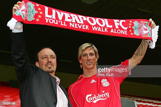 Liverpool football club manager Rafael Benitez welcomes former Athletico Madrid footballer Fernando Torres to Anfield in Liverpool northwest England...