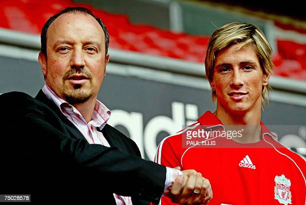 Liverpool football manager Rafael Benitez welcomes former Athletico Madrid footballer Fernando Torres to Anfield Liverpool northwest England 04 July...
