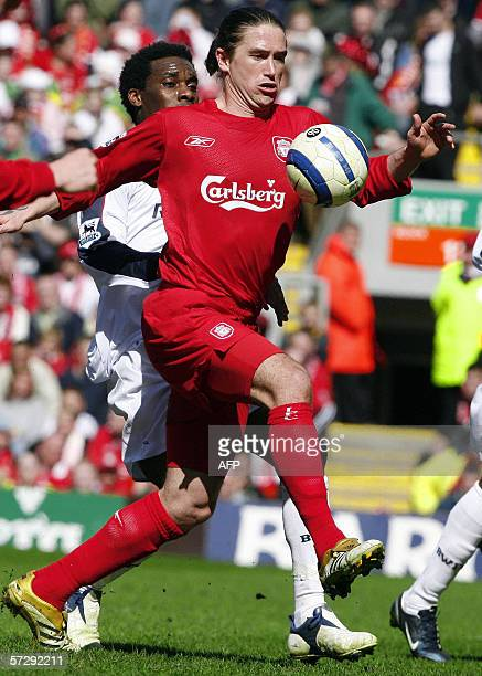 Liverpool, UNITED KINGDOM: Liverpool's Harry Kewell gets to the ball in front of Bolton Wanderers' Jay Jay Okocha during their English Premiership...