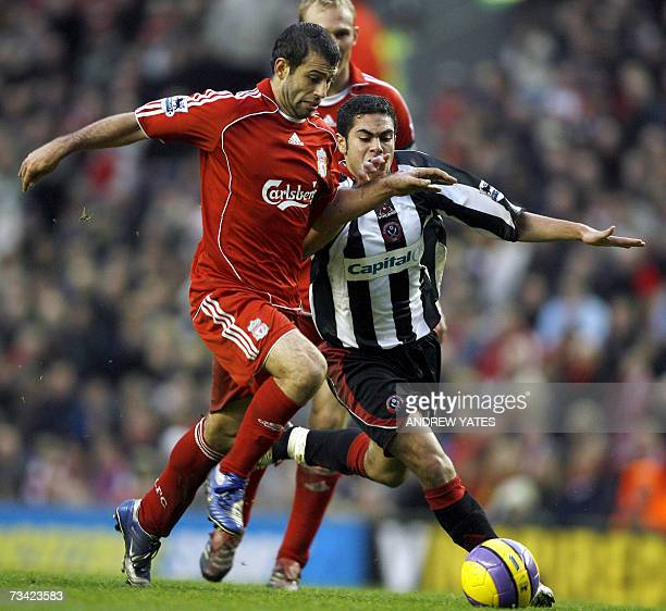 Liverpool's Javier Mascherano vies with Sheffield United's Ahmed Fathi during their English Premiership football match at Anfield Liverpool northwest...