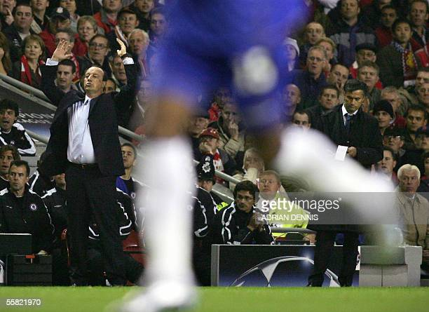 Liverpool's Manager Rafael Benitez gestures to his players while Chelsea's Manager Jose Mourinho takes notes during the Champions League Group G...