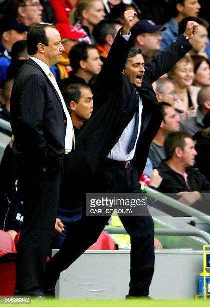 Liverpool's Manager Raphael Benitez looks on as Chelsea's Manager Jose Mourinho celebrates during their premiership match at Anfield football grounds...