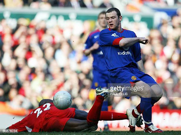 Liverpool's Momo Sissoko challenges Manchester United's Wayne Rooney during their English FA Cup soccer match against Liverpool at Anfield Liverpool...