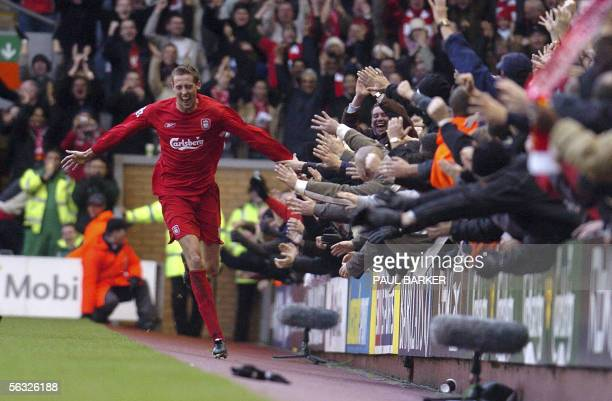 Liverpool's Peter Crouch celebrates after soring his first goal against Wigan during their Premiership match at Anfield in Liverpool 03 December 2005...