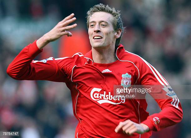 Liverpool's Peter Crouch celebrates scoring a hat trick against Arsenal during their English Premeirship football match at Anfield Liverpool...