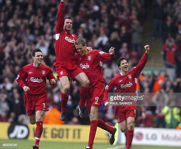Liverpool's Peter Crouch celebrates with Steve Finnan Jamie Carragher and Xabi Alonso after scoring his first goal for Liverpool against Wigan at...