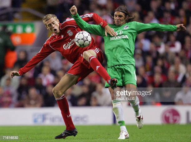 Liverpool, UNITED KINGDOM: Liverpool's Peter Crouch clashes with Maccabi Haifa's Rafael Olarra during a Champions League qualifying match at Anfield,...