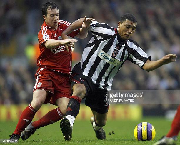 Liverpool's Robbie Fowler vies with Sheffield United's Colin KazimRichards during their English Premiership football match at Anfield Liverpool...