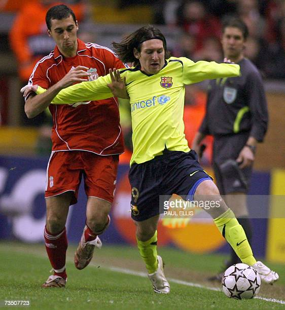 Liverpool's Spanish Alvaro Arbeloa vies with Barcelona's Lionel Messi during their UEFA Champions League first knockout round second leg football...