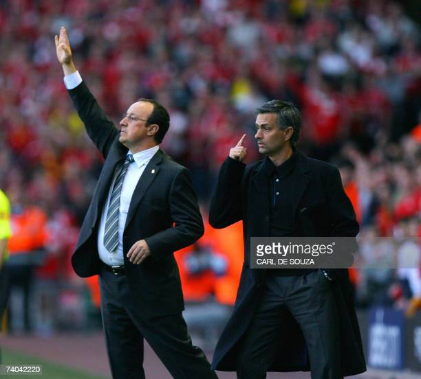 Liverpool's Spanish manager Rafael Benitez and Chelsea's Portuguese manager Jose Mourinho give instructions to their players during their European...