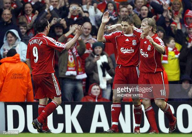 Liverpool's Steven Gerrard celebrates scoring with Robbie Fowler and Dirk Kuyt during their English Premiership football match against Sheffield...