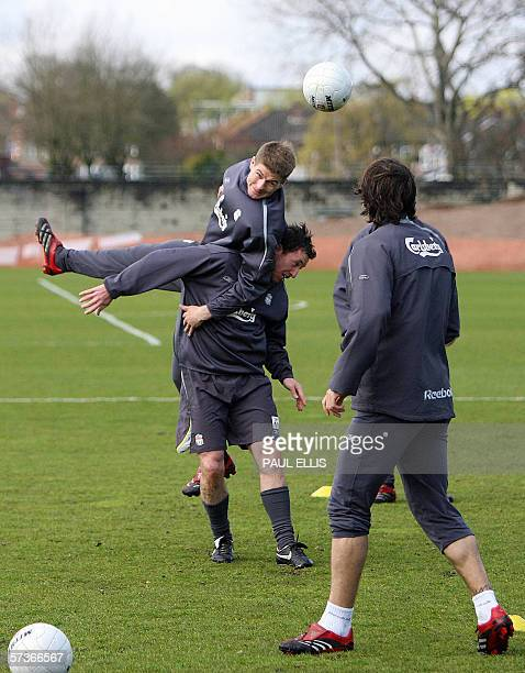 Liverpool's Steven Gerrard jumps above team mate Robbie Foweler during a training session at their Melwood training ground Liverpool England April 19...