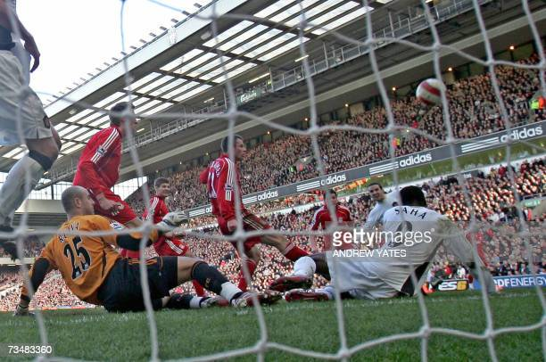 Manchester United's John O'Shea scores during their English Premiership football match against Liverpool at Anfield Liverpool northwest England 03...