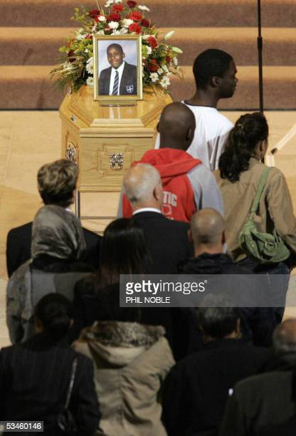 Mourners attend the funeral of murdered black teenager Anthony Walker 25 August 2005 The 18yearold student was bludgeoned with an axe in a park in...