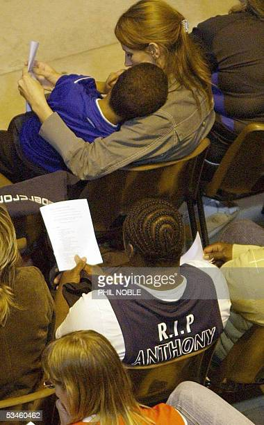Mourners wearing basketball and football shirts during the funeral of murdered teenager Anthony Walker Thursday August 25 2005 The 18yearold student...