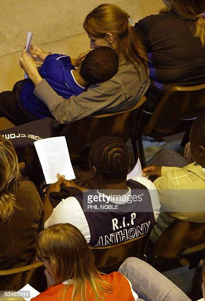 Mourners wearing basketball and football shirts attend the funeral of murdered teenager Anthony Walker 25 August 2005 The 18yearold student was...