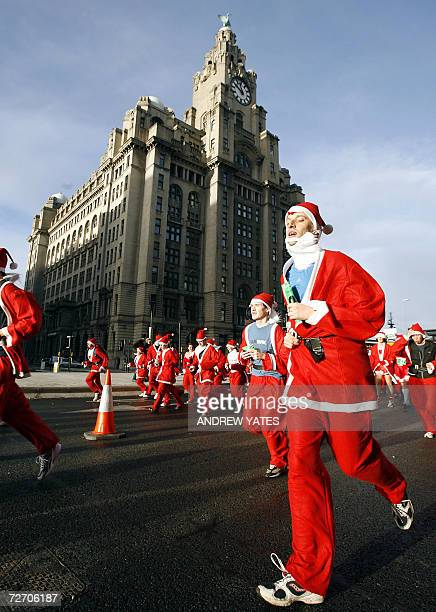 Runners take part in the annual Santa Dash in the center of Liverpool 03 December 2006 AFP PHOTO/ANDREW YATES