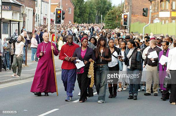 Slain teenager Anthony Walker's mother Gee Walker leads 2000 people in a walk in Huyton Liverpool in memory of the boy 05 August 2005