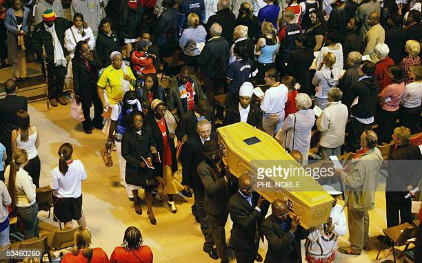 The family of murdered teenager Anthony Walker follow his coffin as it is carried from Liverpool Cathedral following his funeral Thursday August 25...