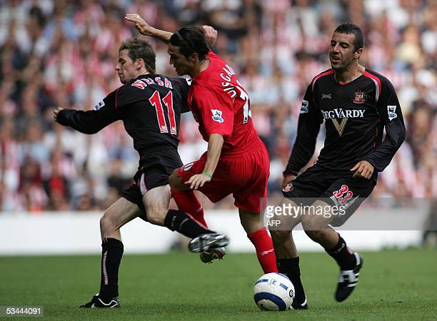Liverpool, UNITED KINGDOM: UK OUT Sunderland's Andy Welsh gets the red card on Liverpool's Luis Garcia watched by Julio Arcaduring the Premiership...