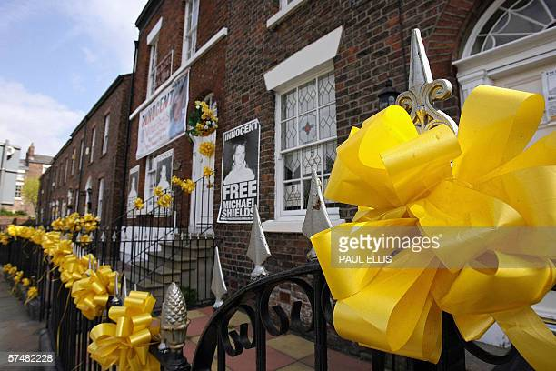 Liverpool, UNITED KINGDOM: Yellow ribbons and posters surround the home of jailed British soccer fan Michael Shields, in Liverpool, in north-west...