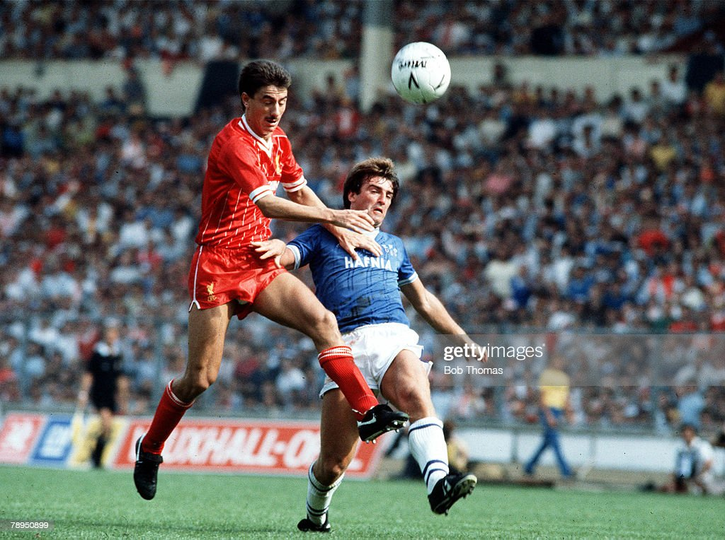 1984-85. Liverpool v Everton. Liverpool's Ian Rush challenges Everton's Kevin Ratcliffe in the air, during the Merseyside derby. : News Photo