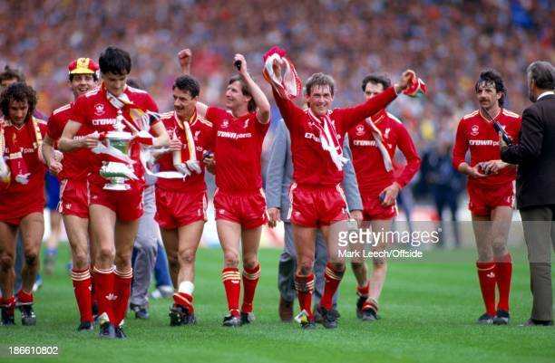 FINAL Liverpool v Everton The Liverpool team led by Kenny Dalglish celebrate their cup final victory