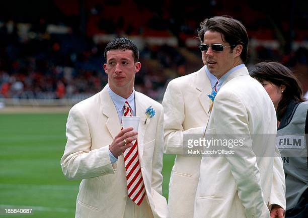 Liverpool v Manchester United, Jamie Redknapp and Robbie Fowler mingle in their white suits before kick off.