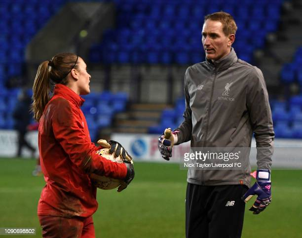 Liverpool Women goalkeeping coach Chris Kirkland talks with Anke Preuss during the WSL game at Prenton Park on January 28 2019 in Birkenhead England
