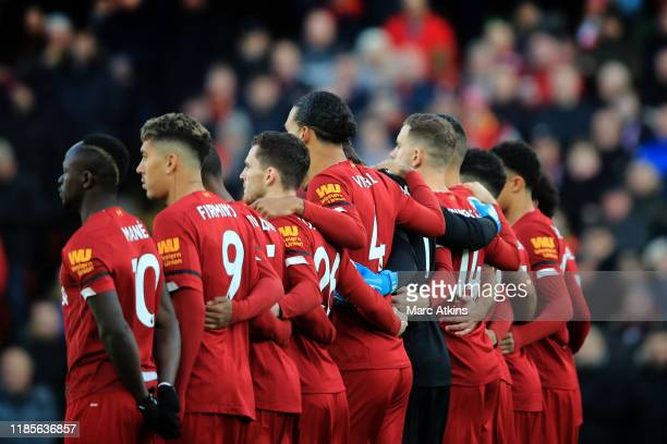 Liverpooll players form a group before a minutes applause during the Premier League match between Liverpool FC and Brighton Hove Albion at Anfield on...
