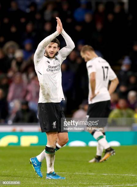 Liverpool's Adam Lallana acknowledges the fans after the final whistle