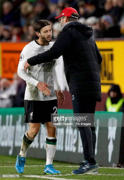 Liverpool's Adam Lallana is substituted off by manager Liverpool manager Jurgen Klopp during the Premier League match at Turf Moor Burnley