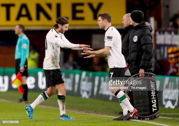 Liverpool's Adam Lallana is substituted off for teammate James Milner during the Premier League match at Turf Moor Burnley