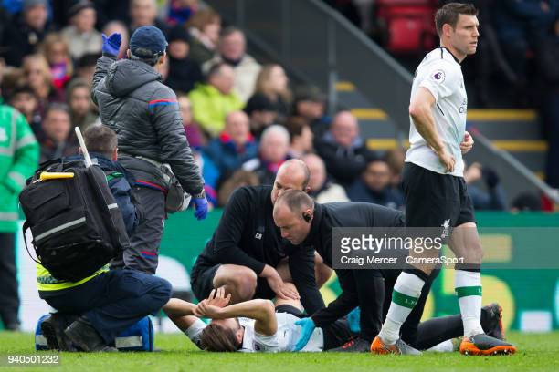 Liverpool's Adam Lallana is treated by medics during the Premier League match between Crystal Palace and Liverpool at Selhurst Park on March 31 2018...