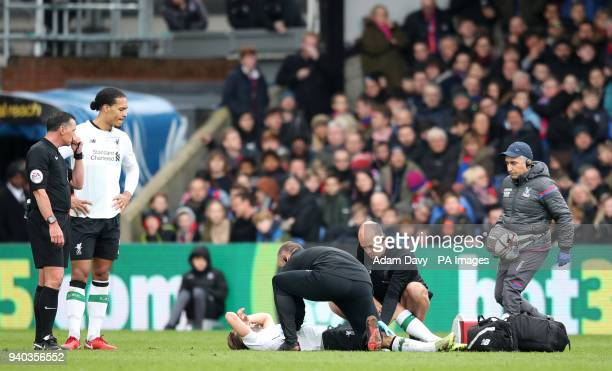 Liverpool's Adam Lallana reacts on the floor injured during the Premier League match at Selhurst Park London