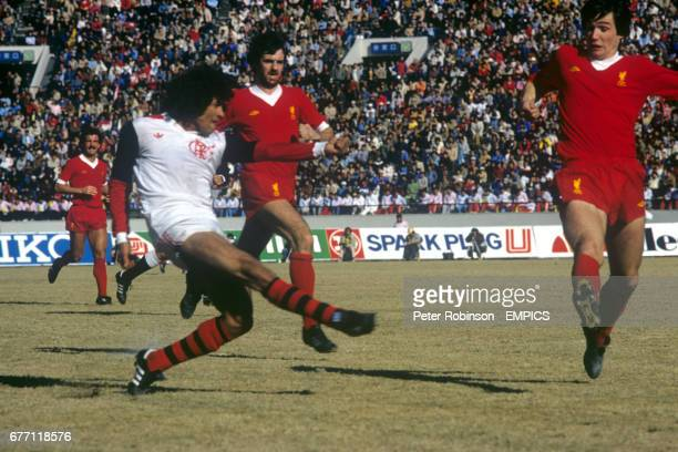 Liverpool's Alan Hansen can't prevent Flamengo's Nunes from scoring the third goal of the game