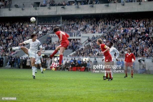 Liverpool's Alan Hansen clears the ball with a header Santillana Alan Hansen Phil Thompson Real Madrid's Englishman Laurie Cunningham and Liverpool's...