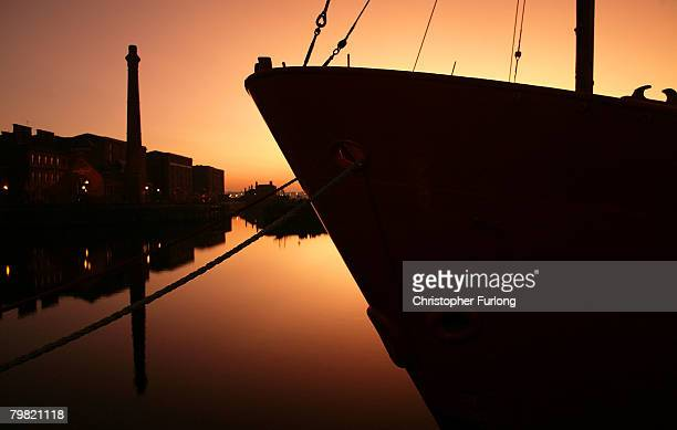 Liverpool's Albert Dock sits against the backdrop of the setting sun on February 17 Liverpool England The historic dock yard is one of Liverpool's...